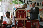 Britain's Prince Philip, Duke of Edinburgh (R) tours the classrooms at Mayflower Primary School during a visit  with Britain's Queen Elizabeth II (not pictured) to Poplar in Tower Hamlets in East London on June 15, 2017, as part of commemorations to mark the centenary of the bombing of Upper North Street School during the First World War..Mayflower Primary School now exists on the site of the Upper North Street School. / AFP PHOTO / POOL / Daniel LEAL-OLIVAS