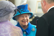 Queen Elizabeth II accompanied by Prince Philip, The Duke of Edinburgh, visiti the Chapel to view the restoration and meet local people involved with the projec tat the Royal Dockyard Chapel during an official visit on April 29, 2014 in Pembroke Dock, United Kingdom. This year sees the 200th anniversary of the town of Pembroke Dock. The Royal Dockyard Chapel has undergone a restoration project to become the base for Pembroke Dock's Heritage Centre which celebrates 200 years of a unique naval and military community.