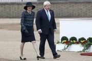British Prime Minister Theresa May and Foreign Secretary Boris Johnson arrive to take part in a ceremonial welcome for Colombia's President Juan Manuel Santos and his wife Maria Clemencia de Santos at Horse Guards Parade on November 1, 2016 in London, England. The President is on a state visit to Britain.