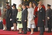Queen Elizabeth II and Prince Philip, Duke of Edinburgh flank Colombia's President Juan Manuel Santos and his wife Maria Clemencia de Santos during a ceremonial welcome for Colombia's President Juan Manuel Santos and his wife Maria Clemencia de Santos at Horse Guards Parade on November 1, 2016 in London, England. The President is on a state visit to Britain.