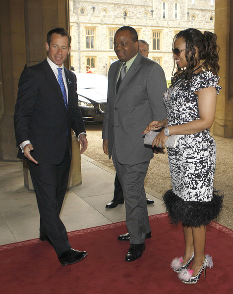 King Mswati III of Swaziland and Inkhosikati LaMbikiza are greeted by household staff as they arrive at a lunch For Sovereign Monarchs in honour of Queen Elizabeth II's Diamond Jubilee, at Windsor Castle, on May 18, 2012 in Windsor, England.