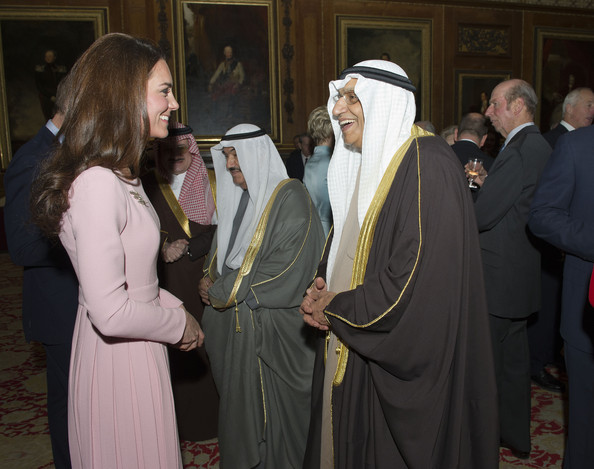 Catherine, Duchess of Cambridge speaks with guests during a reception in the Waterloo Chamber, before the Lunch For Sovereign Monarchs at Windsor Castle, on May 18, 2012 in Windsor, England.