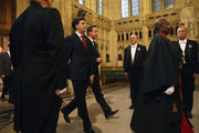 British Prime Minister David Cameron and Leader of the Labour Party Ed Miliband walk through the Members' Lobby after the Queen's Speech at the State Opening of Parliament on June 4, 2014 in London, England. Queen Elizabeth II unveiled the coalition government's legislative programme in a speech delivered to Members of Parliament and Peers in The House of Lords. Proposed legislation is expected to be introduced on a 5p charge for plastic bags in England, funding of workplace pensions, new state-funded childcare subsidy and reforms to speed up infrastructure projects.