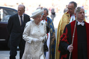 Queen Elizabeth II arrives with Prince Philip, Duke of Edinburgh (L) and Dean of Westminster, The Very Reverend Dr John Hall (R) for a celebration to mark the 60th anniversary of the Coronation Queen Elizabeth II at Westminster Abbey on June 4, 2013 in London, England.  The Queen's Coronation took place on June 2, 1953 after a period of mourning for her father King George VI, following her ascension to the throne on February 6, 1952. The event 60 years ago was the first time a coronation was televised for the public.