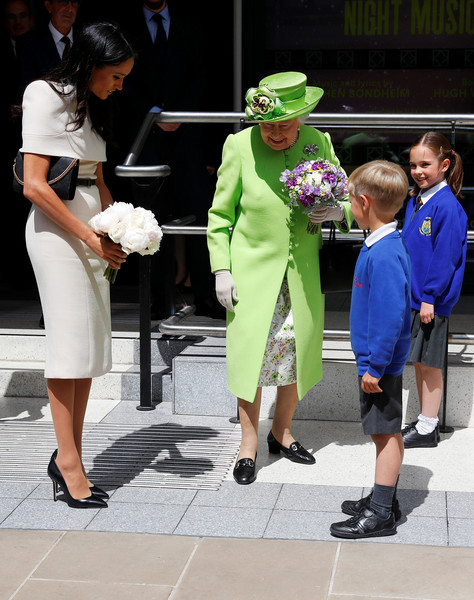 The Duchess Of Sussex Undertakes Her First Official Engagement With Queen Elizabeth II [duchess of sussex undertakes her first official engagement with,green,fashion,leg,event,tourism,performance,vacation,plant,street,street fashion,elizabeth ii,meghan markle,harry,pair,the storyhouse,chester town hall,sussex,road bridge,the duchess]