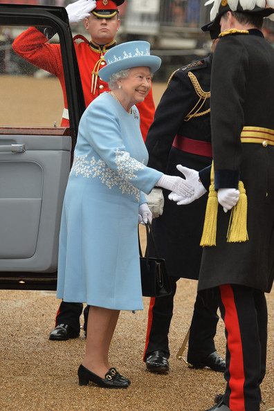 Queen Elizabeth II arrives at Horse Guards Parade where she will present the Household Cavalry with new standards, on May 28, in 2014 in London, Untied Kingdom.