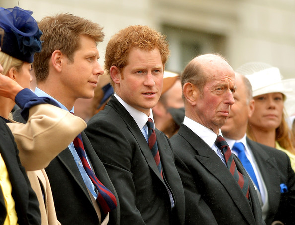 Prince Harry (c) with the Prince Edward, Duke of Kent (r) watch Queen Elizabeth II as she presents the Household Cavalry with new standards at Horse Guards Parade, on May 28, 2014 in London, Untied Kingdom.