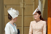 Anne, Princess Royal and Catherine, Duchess of Cambridge talk during a garden party held at Buckingham Palace on June 10, 2014 in London, England.
