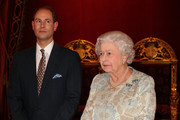 Queen Elizabeth II (R) with Prince Edward, Earl of Wessex during her reception to celebrate the patronages & affiliations of the Earl and Countess of Wessex at Buckingham Palace on February 10, 2015 in London, England