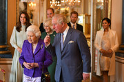 Queen Elizabeth II and Meghan Markle Photos Photo