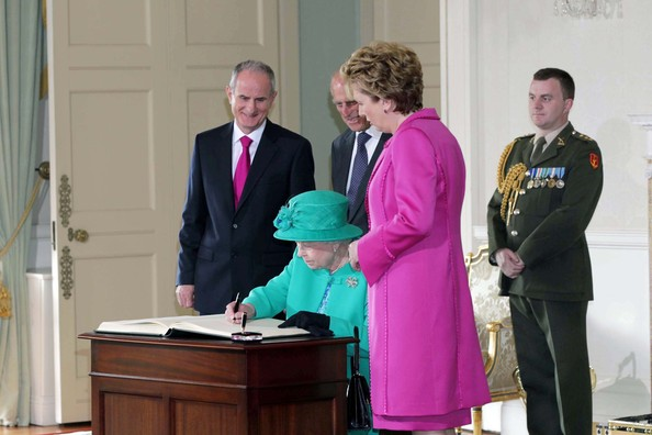 Queen Elizabeth II Queen Elizabeth II signs the visitors book as Prince Philip The Duke of Edinburgh, President Mary Mc Aleese, and Dr Martin Mc Aleese look on at Aras An Uachtarain on May 17, 2011 in Dublin,Ireland. The Queen's visit, accompanied by The Duke of Edinburgh, is the first by a monarch since 1911. An unprecedented security operation is taking place with much of the centre of Dublin turning into a car free zone. Republican dissident groups have made it clear they are intent on disrupting proceedings.
