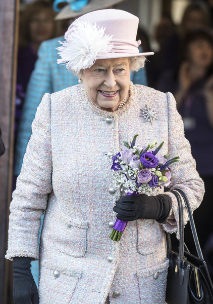 The Queen Visits West Sussex [headgear,fashion accessory,fashion,headpiece,hair accessory,tradition,hat,haute couture,suit,flower,people,queen,consideration,canine partner dogs,dogs,disabilities,west sussex,headquarters,canine partners,charity,elizabeth ii,wedding of prince harry and meghan markle,windsor castle,2018,british royal family,tarot,model]
