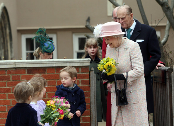 The Royal Family Attend The Easter Matins Service At Windsor Castle [the royal family,ceremony,event,wedding,marriage,floristry,wedding dress,flower arranging,flower,floral design,plant,elizabeth ii,children,service,flowers,windsor castle,grounds,england,easter matins service,easter day]