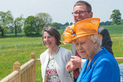 Queen Elizabeth II visits one of the Duchy of Lancaster Farms where she met tenants John and Victoria Coupland and young Equestrians at the Eland Lodge Equestrian centre on May 25, 2017 in Staffordshire, United Kingdom.