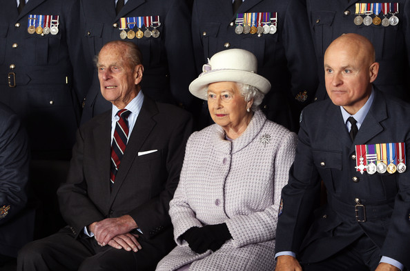 Prince Philip, Duke of Edinburgh and Queen Elizabeth II pose for a photo during a visit to RAF Lossiemouth on their 67th wedding anniversary on November 20, 2014 in Lossiemouth, Scotland. It was the Queen's first visit to the base since 2003.