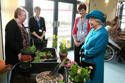 Queen Elizabeth II talks to patient Christina Hutson (L), watched by staff members  Emma Shaw (2L) and Nicola Child as she visits The Norfolk Hospice at Hillington on February 4, 2016 near King's Lynn, England. The Queen met patients, trustees, volunteers and medical professionals working at the hospice, which has been serving its local community close to her Sandringham Estate for over 30 years.