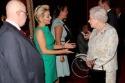 Queen Elizabeth II meets actors Sheriden Smith (2nd L) and Matt Lucas (L)during her reception to celebrate the patronages & affiliations of the Earl and Countess of Wessex at Buckingham Palace on February 10, 2015 in London, England