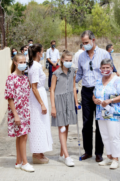 Spanish Royals Visit A Socio-Educational Center In Mallorca [photograph,white,photograph,people,event,fashion,adaptation,dress,photography,tourism,vacation,dress,royals,felipe vi,letizia,sofia,leonor,spain,socio-educational center in mallorca,spanish,dress,ceremony,clothing]