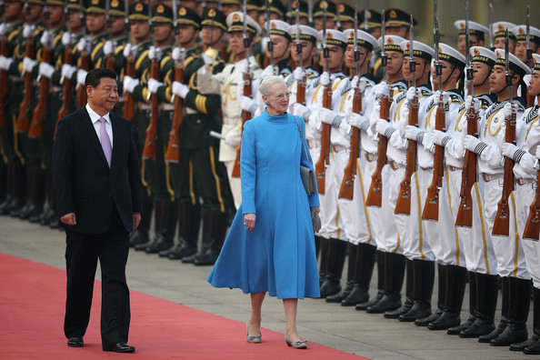Chinese President Xi Jinping (L) accompanies Queen Margrethe II of Denmark (R) to view an honour guard during a welcoming ceremony outside the Great Hall of the People on April 24, 2014 in Beijing, China. Queen Margrethe II and Prince Henrik of Denmark are on a vist to China from April 24 to 28.
