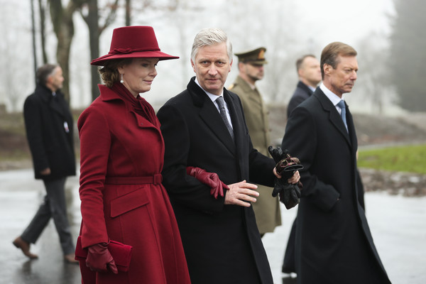 King Philippe Of Belgium And Queen Mathilde Attend The 75th Battle Of The Bulge Anniversary Remembrance Ceremony In Bastogne [battle of the bulge,fashion,suit,event,formal wear,headgear,tradition,coat,hat,fashion accessory,white-collar worker,philippe of belgium,mathilde,henri grand duke of luxembourg,anniversary remembrance ceremony in bastogne,l-r,belgium,bastogne,remembrance ceremony]