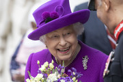 Queen Elizabeth II holds a bouquet as she opens the new premises of the Royal National ENT and Eastman Dental Hospital on February 19, 2020 in London, England.