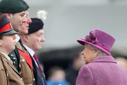 Queen Elizabeth II (R) greets members of The Royal Welsh as she attends a review and presents Leeks to The Royal Welsh to mark St David's Day at Lucknow Barracks on March 3, 2017 in Tidworth, England.