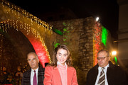 FUHEIS, JORDAN- DECEMBER 16: In this handout photo provided by the Royal Hashemite Court, Queen Rania of Jordan takes part in the lighting of the Christmas tree on December 16, 2018 in Fuheis city near Amman, Jordan. Fuheis city is a Christian town located near Amman.
