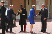 Prime Minister Theresa May and her husband Philip May are greeted by Rt Hon Edward Young, private secretary to the Queen and Major Nana Twumasi-Ankrah, Household Cavalry Regiment as they arrive at Buckingham Palace on July 24, 2019 in London, England. The British monarch remains politically neutral and the incoming Prime Minister visits the Palace to satisfy the Queen that they can form her government by being able to command a majority, holding the greater number of seats, in Parliament. Then the Court Circular records that a new Prime Minister has been appointed.