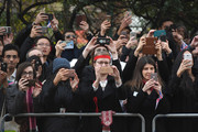 Members of the public take photographs as Queen Elizabeth II departs Goodenough College after a visit on December 1, 2016 in London, England.  Goodenough College is the leading residential community for British and international postgraduate students studying in London.