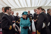Queen Elizabeth II is greeted by Commander Andrew Canale (L), MVO, RN during a reception as she visits HMS Sutherland in the West India Dock as the ship celebrates its 20th anniversary of her Commissioning on October 23, 2017 in London, England.