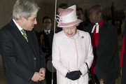 Queen Elizabeth II looks at the plaque dedicated to Nelson Mandela as she visits the Palace of Westminster to view the Diamond Jubilee Window which has been installed in the Great Window of Westminster Hall on December 6, 2013 in London, England.