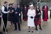 Queen Elizabeth visits the Palace of Westminster to view the Diamond Jubilee Window which has been installed in the Great Window of Westminster Hall, accompanied by House of Lords Speaker Baroness D'Souza (R) and House of Commons Speaker John Bercow (2nd L) on December 6, 2013 in London, England.