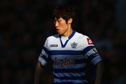 Ji-Sung Park of Queens Park Rangers runs with the ball during the Barclays Premier League match between Queens Park Rangers and Arsenal at Loftus Road on May 04, 2013 in London, England.