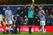 Mauricio Isla of QPR (14) reacts as he is shown a yellow card by referee Mike Dean during the Barclays Premier League match between Queens Park Rangers and Manchester City at Loftus Road on November 8, 2014 in London, England.