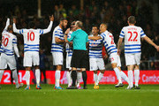 QPR players protest to referee Mike Dean as Charlie Austin's goal is disallowed during the Barclays Premier League match between Queens Park Rangers and Manchester City at Loftus Road on November 8, 2014 in London, England.