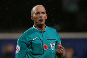 Referee Mike Dean during the Barclays Premier League match between Queens Park rangers and Manchester City at Loftus Road on November 8, 2014 in London, England.