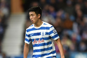 Suk-Young Yun of Queens Park Rangers in action during the Barclays Premier League match between Queens Park Rangers and West Bromwich Albion at Loftus Road on December 20, 2014 in London, England.
