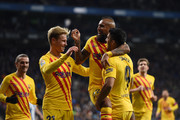 Arturo Vidal of FC Barcelona celebrates with teammates after scoring his team's second goal during the La Liga match between RCD Espanyol and FC Barcelona at RCDE Stadium on January 04, 2020 in Barcelona, Spain.