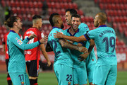 Arturo Vidal of FC Barcelona celebrates with Sergi Roberto and teammates after scoring his sides first goal during the La Liga match between RCD Mallorca and FC Barcelona at Estadio de Son Moix on June 13, 2020 in Mallorca, Spain.