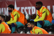 Luis Suarez of FC Barcelona wears a protective mask on the substitutes bench during the La Liga match between RCD Mallorca and FC Barcelona at Estadio de Son Moix on June 13, 2020 in Mallorca, Spain.