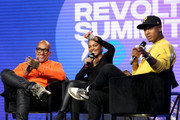 (L-R) Kenya Barris, China Anne McClain and Terrence J speak onstage at the REVOLT X AT&T Host REVOLT Summit In Los Angeles at Magic Box on October 27, 2019 in Los Angeles, California.