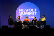 (L-R) Chadwick Boseman, Nkechi Carol, Kenya Barris, China Anne McClain and Terrence J speak speak onstage at the REVOLT X AT&T Host REVOLT Summit In Los Angeles at Magic Box on October 27, 2019 in Los Angeles, California.