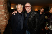 """Director Alfonso Cuarón (L) and Peter Fonda attend """"ROMA"""" Tastemakers at Chateau Marmont on January 12, 2019 in Los Angeles, California."""