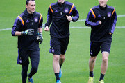 (L-R)  Silvio Proto, Sacha Kljestan and Olivier Deschacht warm up during the R.S.C. Anderlecht training session held at Constant Vanden Stock Stadium on October 21, 2014 in Brussels, Belgium. Anderlecht and Arsenal will play tomorrow night in their Group D UEFA Champions League match.