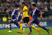 Andy Najar of Anderlecht chases Pierre-Emerick Aubameyang of Borussia Dortmund during the UEFA Champions League Group D match between RSC Anderlecht and Borussia Dortmund at Constant Vanden Stock Stadium on October 1, 2014 in Anderlecht, Belgium.