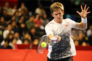 Kevin Anderson of South Africa  plays a fourhand in the Singles second round against Frances Tiafoe of the United States on day four of the Rakuten Open at Musashino Forest Sports Plaza on October 4, 2018 in Chofu, Tokyo, Japan.