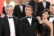 "(L-R) Victor Hadida, Sylvester Stallone and Paz Vega attend the screening of ""Rambo - First Blood"" during the 72nd annual Cannes Film Festival on May 24, 2019 in Cannes, France."