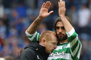 Neil Lennon (L) coach of Celtic embraces Georgios Samaras at the end of the Clydesdale Bank Premier League match between Rangers and Celtic at Ibrox Stadium on April 24, 2011 in Glasgow, Scotland.