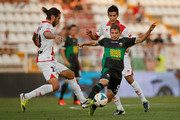 Joaquin Larrivey (L) of Rayo Vallecano de Madrid competes for the ball with Alberto Rivera (R) of  Elche FC as Alberto Bueno of Rayo Vallecano de Madrid follows them during the La Liga match between Rayo Vallecano de Madrid and Elche FC at Estadio Teresa Rivero on August 19, 2013 in Madrid, Spain.