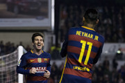 Lionel Messi (L)  of FC Barcelona celebrates scoring their second goal with teammate Neymar JR. (R) during the La Liga match between Rayo Vallecano de Madrid and FC Barcelona at Estadio de Vallecas on March 3, 2016 in Madrid, Spain.